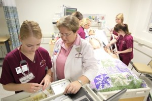 Nursing students learn patient care from medical mannequins.
