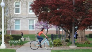 Student rides her bike on campus