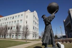 scholar statue strong public affairs