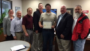 Wes and a group of geologists posing for a picture with his award.