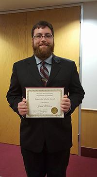 Zach Wilson with his award.