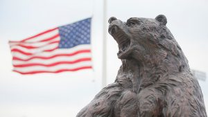 The Bronze Bear in front of the U.S. flag