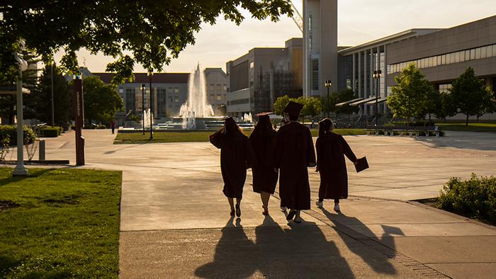 Graduates strolling on campus