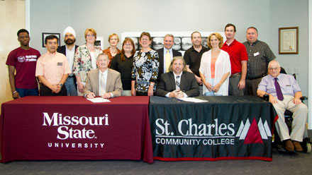Signing at St. Charles Community College