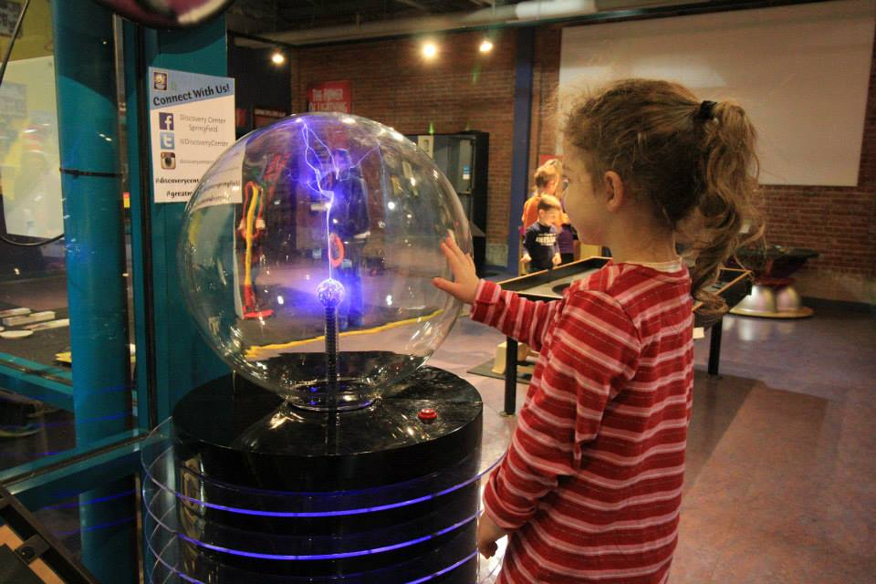 Girl experimenting at Discovery Center