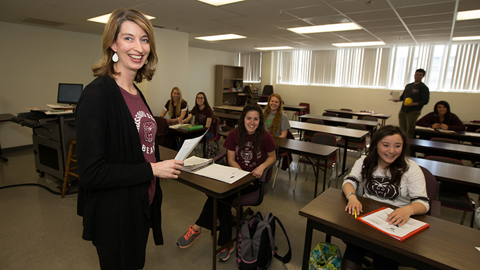 Natalie Allen in a classroom with students.