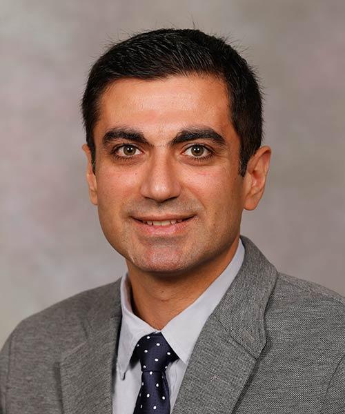 A head shot of Dr. Behzaden.