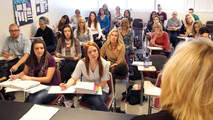 Students listen to professor