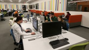 Students working in a computer lab in Glass Hall.
