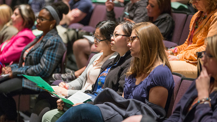 Students listening at conference