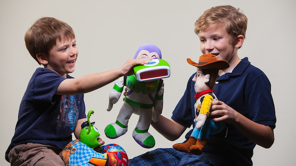 Kids playing with Pixar toys