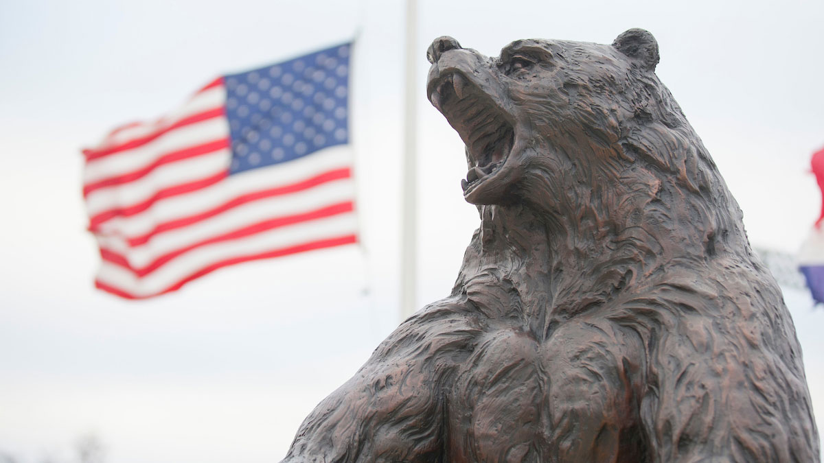 Bear statue and American flag