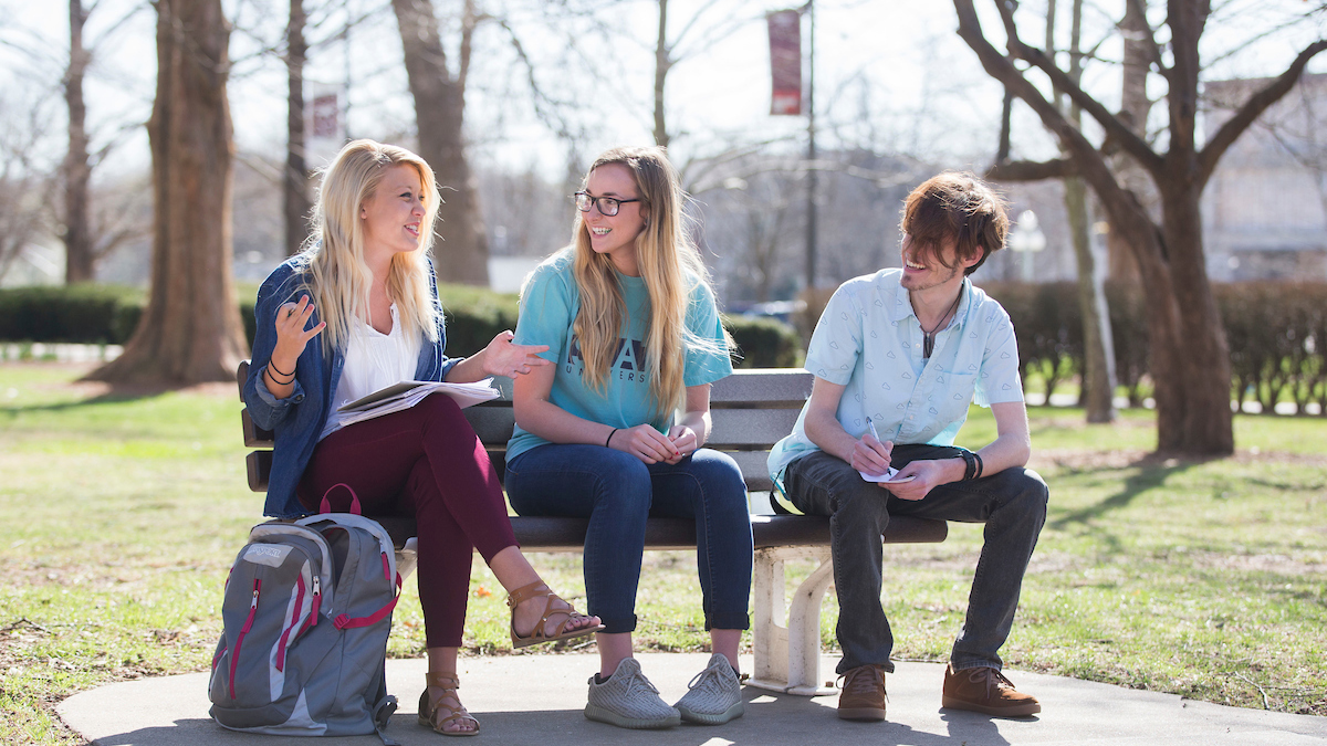 Students sit on a bench