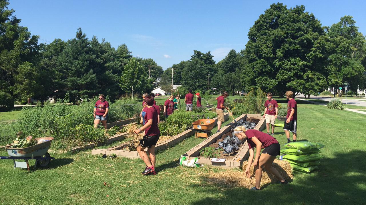 Students working in campus garden.
