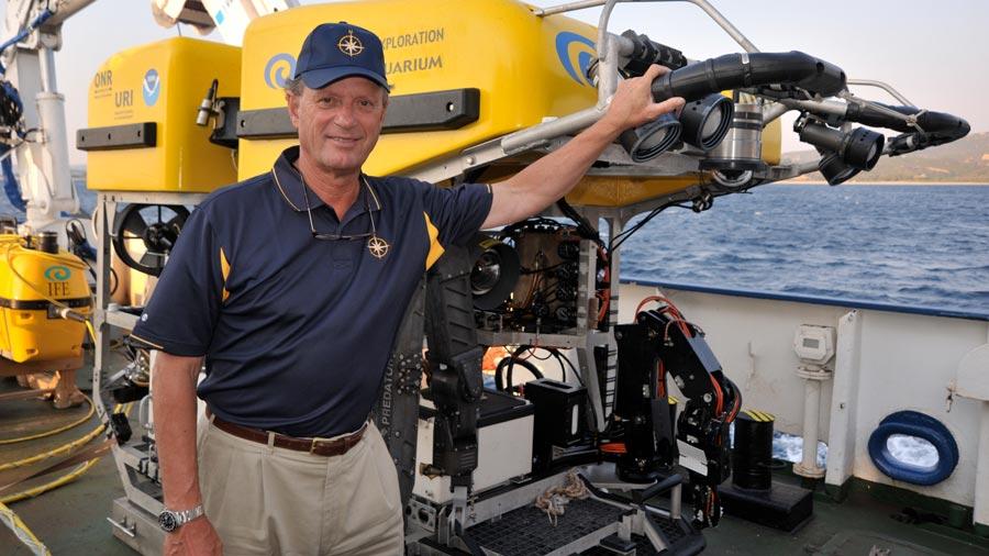 Dr. Robert Ballard with a yellow sea exploration machine
