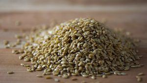 A pile of golden flaxseeds