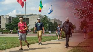 MSU students walk past international flags on campus