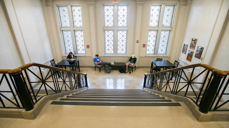 Students studying in front of stairs at Siceluff Hall
