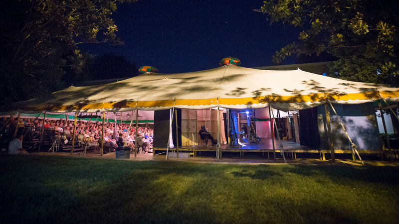 The Tent Theatre exterior at night