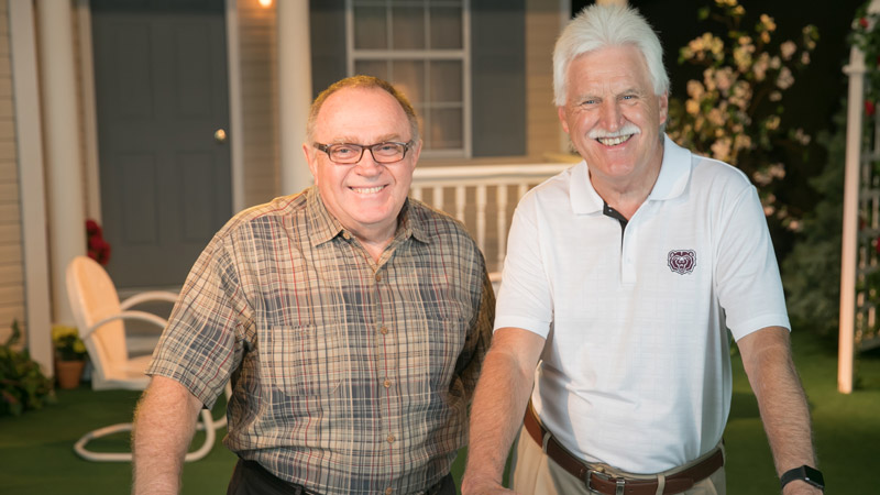 OPTV's Dale Moore and Jim Baker stand on the OPTV set