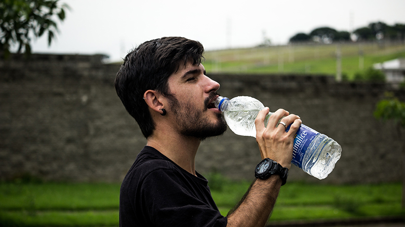 A man drinking bottled water.