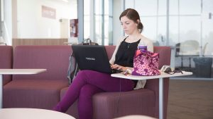 A student types on her laptop.