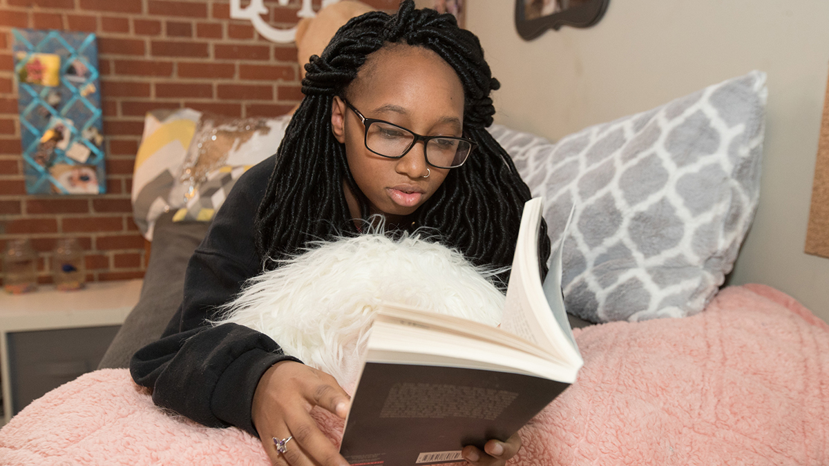 Student reads in room