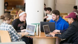Several students participate in a group study session.
