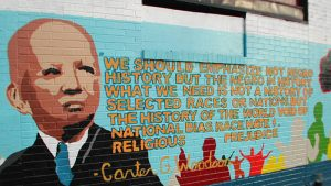 A mural of Carter Woodson and his quote on Black history.