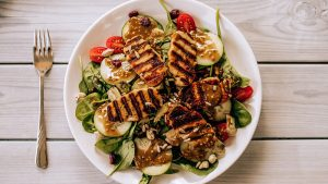 A plate of chicken and salad.