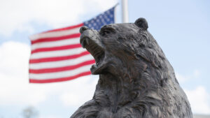 Bear statue in front of American flag