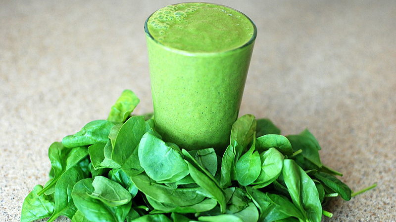 A glass of green smoothie.