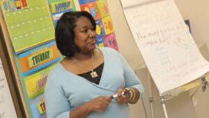 A female African American teacher in a classroom.