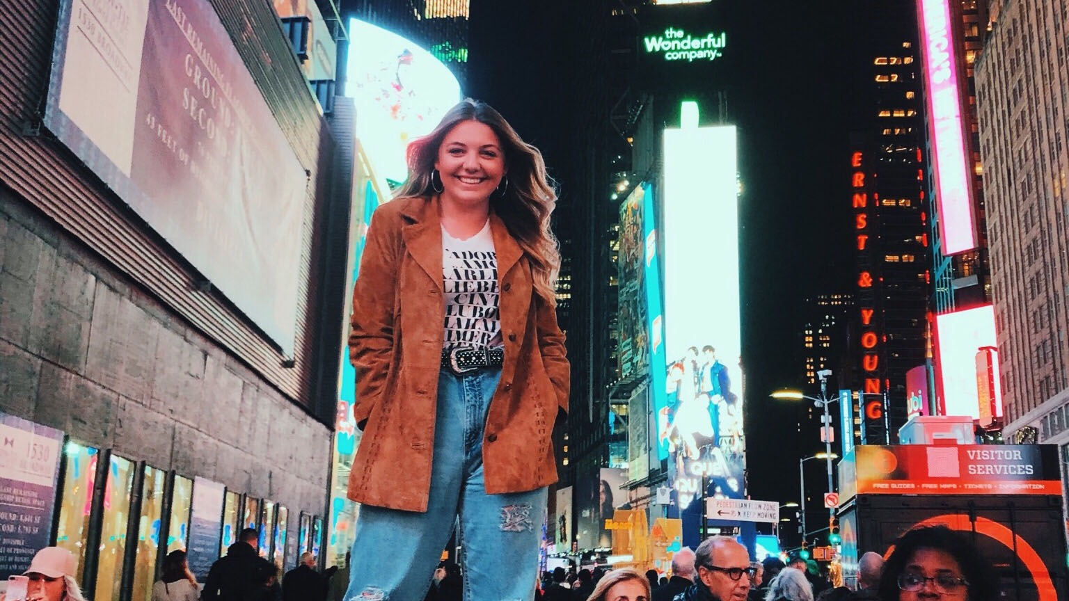 Katie Sulzner standing in Times Square in New York.