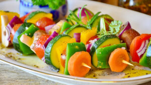 A plate of vegetable skewers.