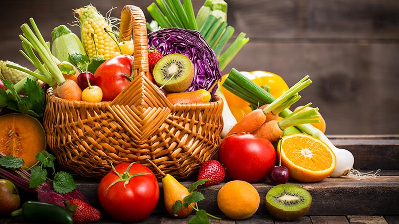 Fresh fruits and vegetables in the basket.