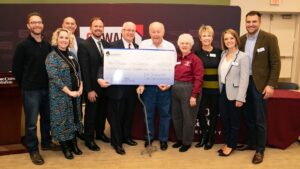 The Darr family presents a check to Missouri State.