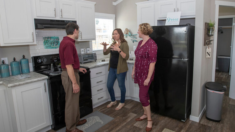 Rohall, Watson and Evans talk inside kitchen of Eden Village home
