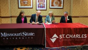 MSU President Clif Smart signs the agreement.