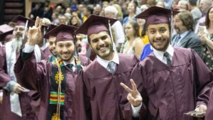 Three #BearGrads celebrate at commencement.