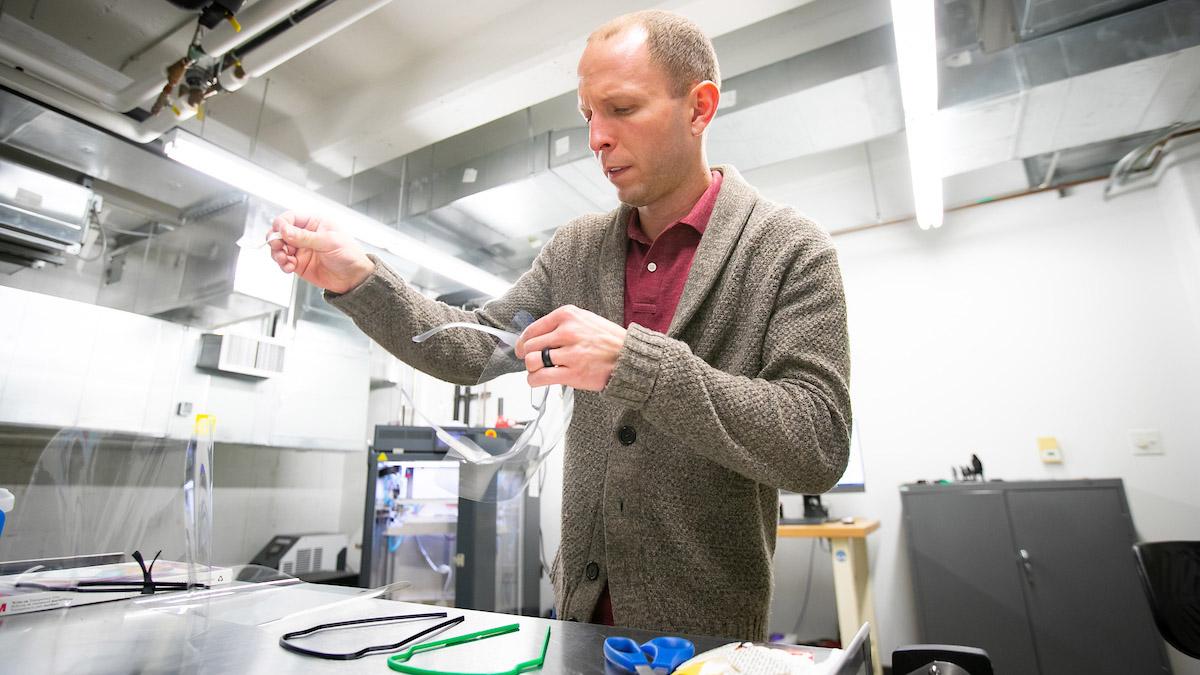 man working at desk in lab