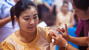 A woman getting vaccinated.