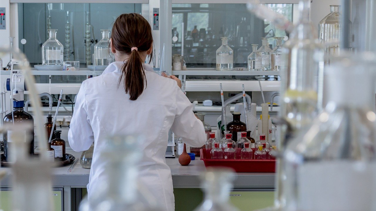 A female chemist working in a laboratory.