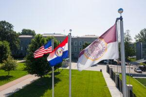 The Missouri flag, MSU's flag, and the American flag.