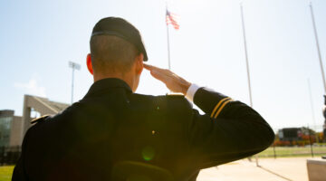 A veteran salutes the American flag on Missouri State's campus.