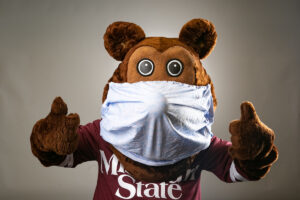 Bear mascot wearing a face mask.