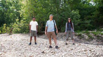 Graduate student Sujan Thapa (left) and Dr. Courtney Coleman (right) accompany Dr. Laszlo Kovacs on a trip to Swan Creek.