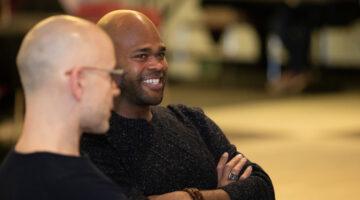 Kyler Sherman-Wilkins sits at Black History Month Banquet.