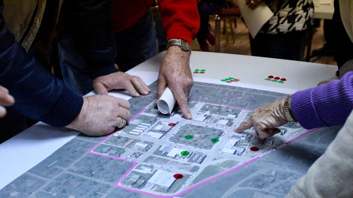 Community members examine aerial map of Seymour.