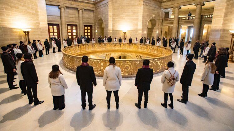 The Missouri State University Chorale rehearses in the Missouri capitol building rotunda.
